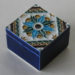 Small ceramic box with tile lid